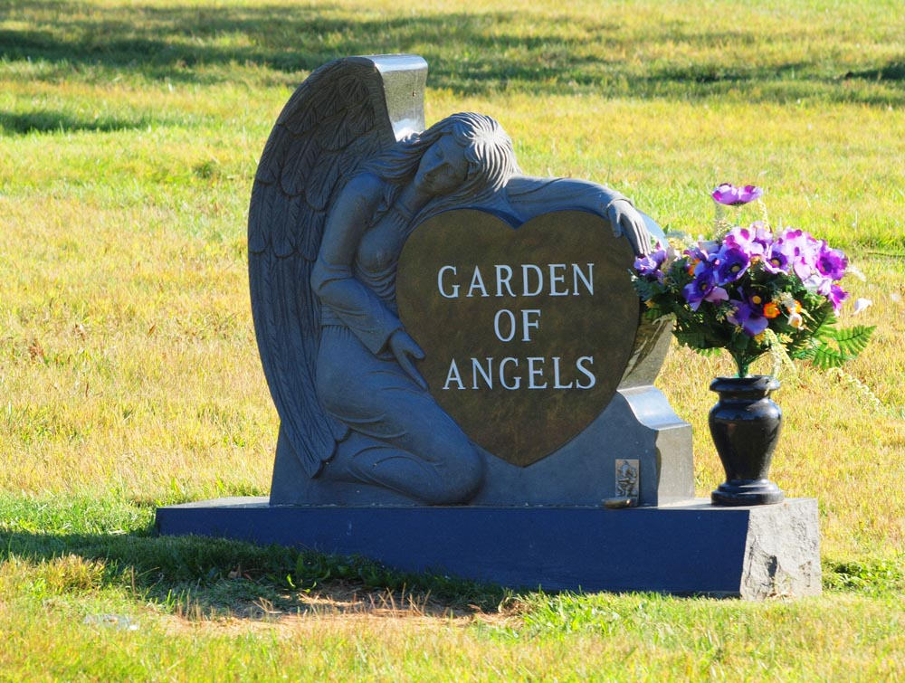 Crafted head stone and flowers